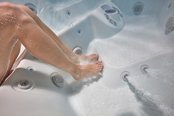 An underwater image of the perfect hot tub seat position in relation to the massage jets