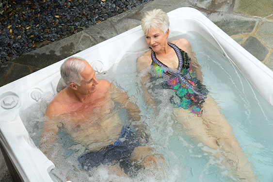 a couple enjoys easier hot tub water care maintenance without laundry detergent