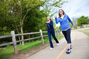 ladies walk a country road faster to burn more calories