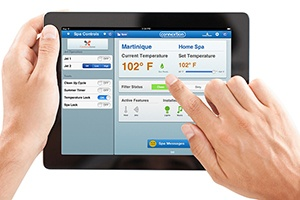 a hot tub owner is able to remotely monitor and control their hot tub with the online remote hot tub monitoring system