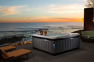 a couple enjoys a sunset soak in their hot tub spa
