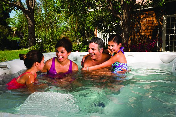 ideas for quality family time as a family with young children relaxes and talks in their hot tub