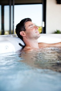 a guy kicks back and relaxes in a vacanza tarino hot tub jacuzzi