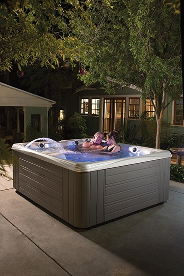 The purple lighting effects of a Caldera hot tub are said to help soothe and smooth conflict