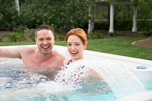 a couple enjoy the perfect hot tub spa after doing good research