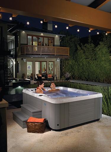 a beautiful backyard with a couple in a Paradise Kauai Hot Tub Spa