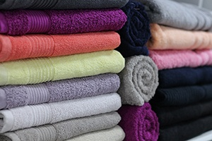 a neatly folded stack of bath towels represents an organized hot tub shopping approach