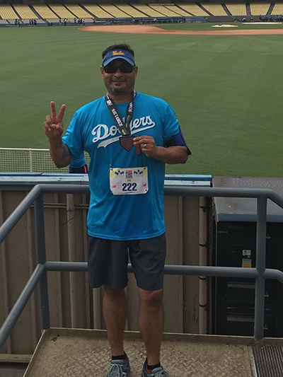 Stephen Acuna poses at Dodger Stadium after completing a long foot race
