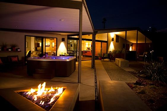 Image of a hot tub on a beautiful modern style backyard at night