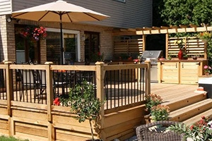 an image of a backyard deck with a hot tub