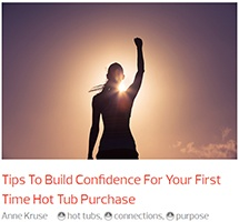 a woman triumphantly salutes the screen because she has learned tips to build confidence for buying the best hot tub in the world
