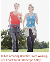 Two women walk and converse as they get amazing benefits from walking ten thousand steps a day