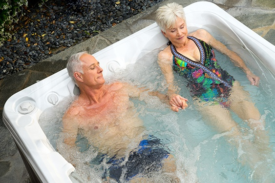 an older couple sleeps better and falls asleep faster after a soak in their hot tub