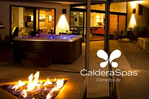 A beautiful backyard fire pit with a Caldera hot tub