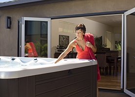 an image of a lady thinking about recycling her hot tub grey water