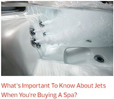 an interior image of a hot tub showing the many jets surrounded by stainless steel rings