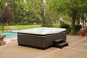 the beautiful utopia cantabria sits on a patio with hot tub steps demonstrating how a hot tub complements your personal world
