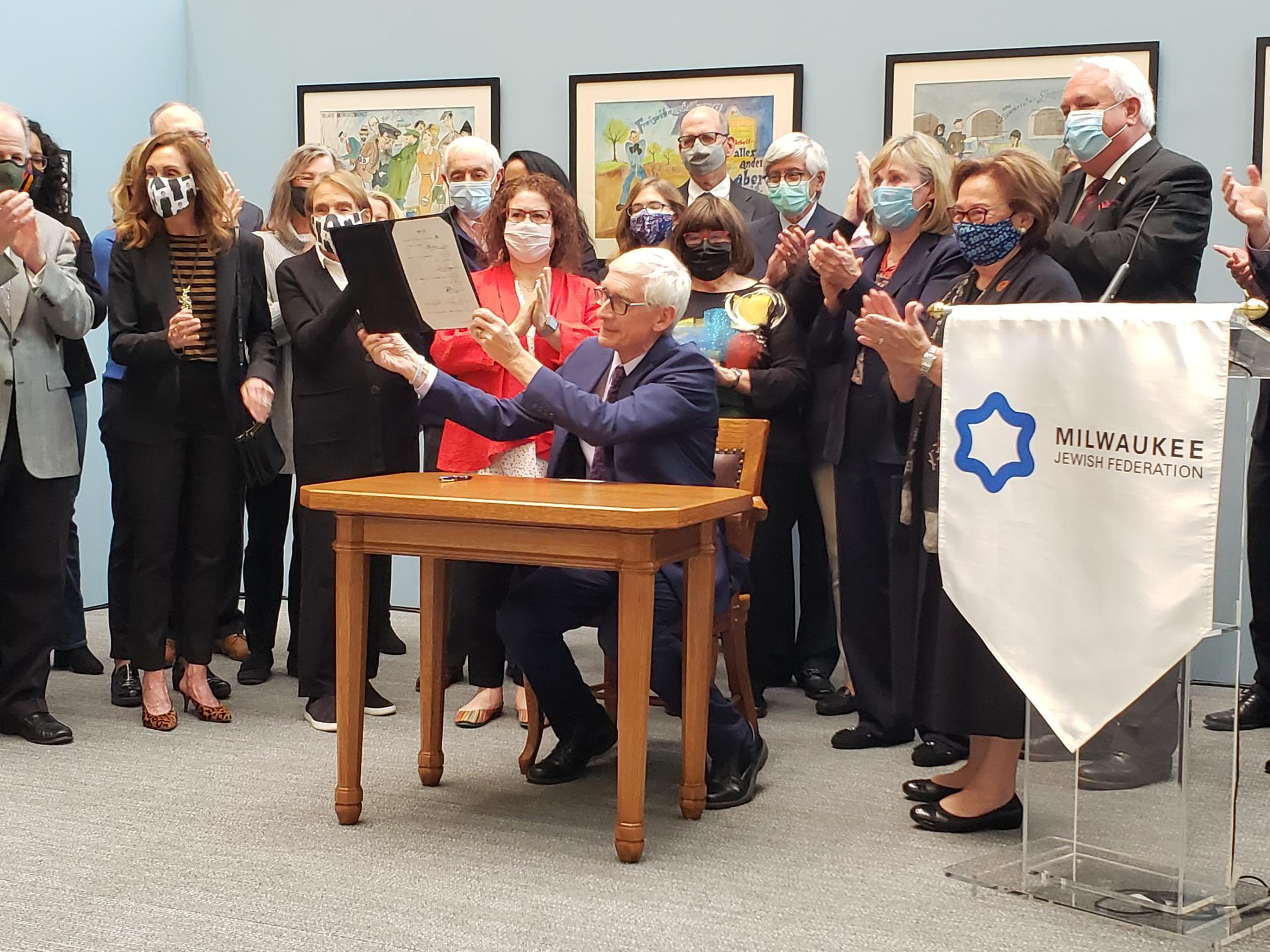 Gov. Evers signs legislation requiring Holocaust education in Wisconsin Schools on Wednesday in Milwaukee.
