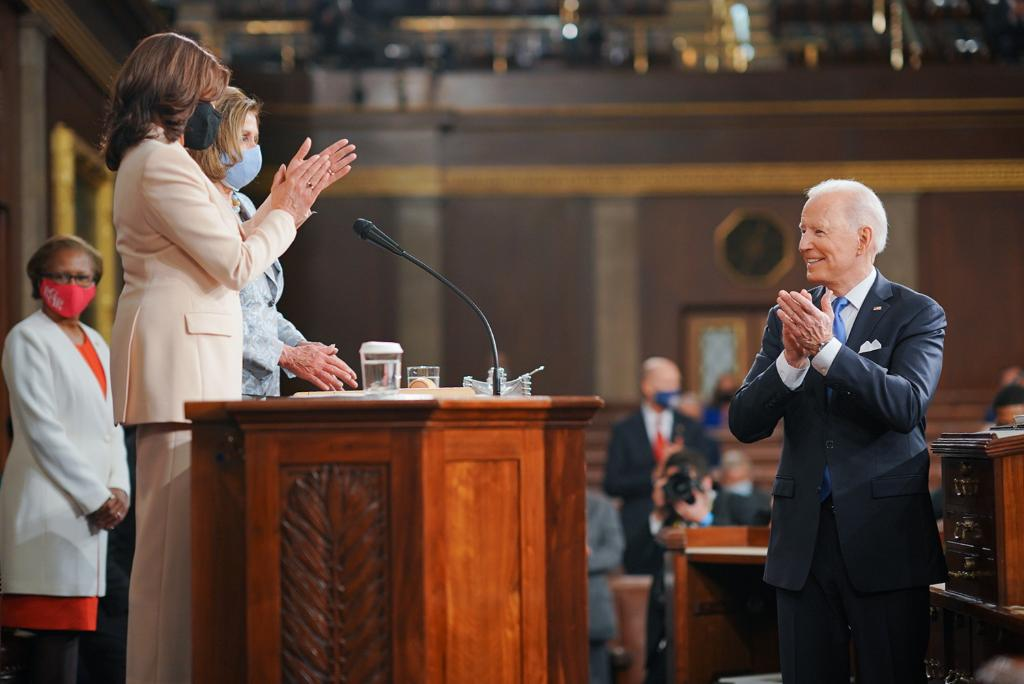 President Biden greets Vice President Harris and Speaker Nancy Pelosi before addressing a joint session of Congress on Wednesday.