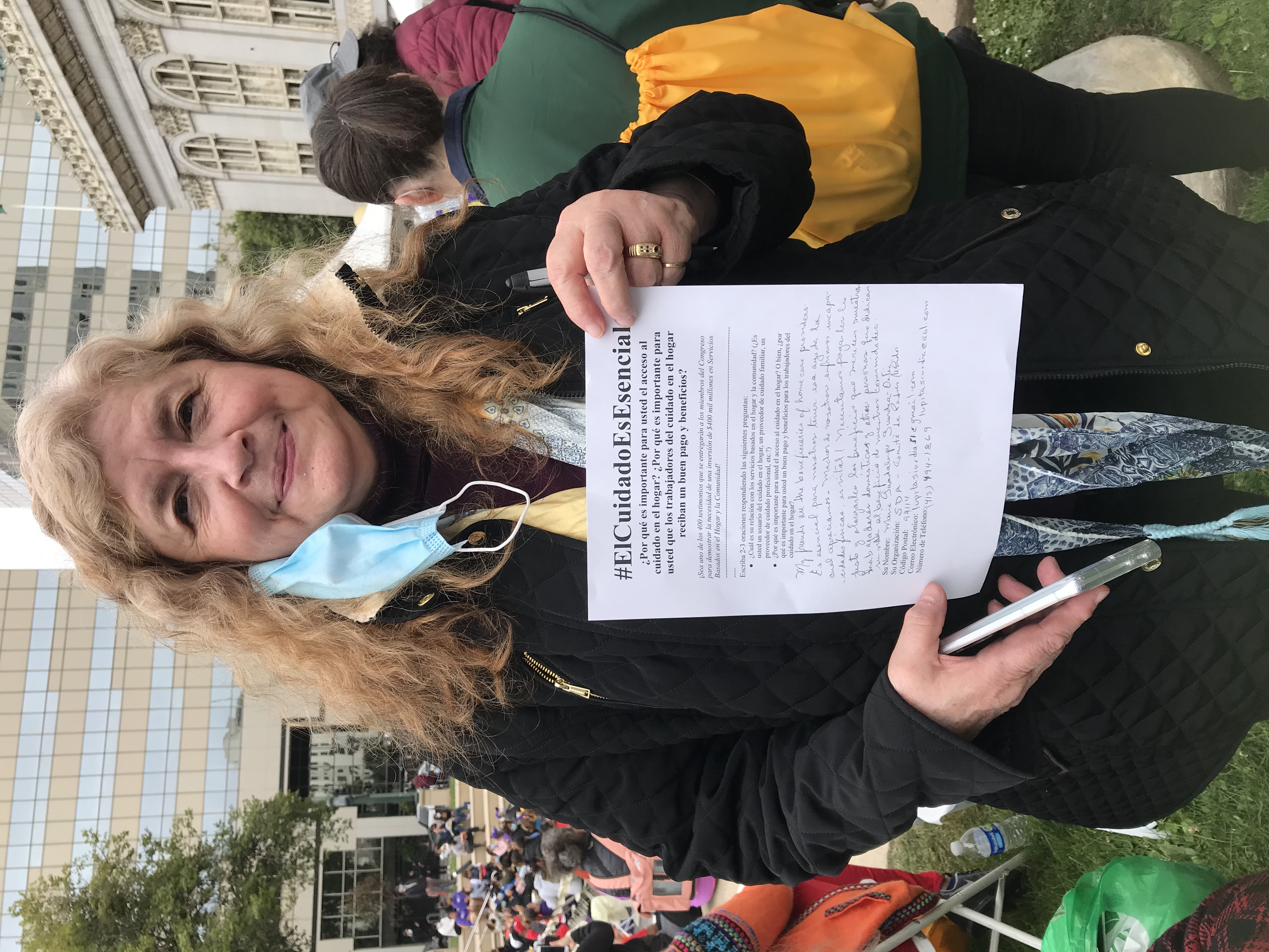 Image Description: SDA Member holding a print version of their