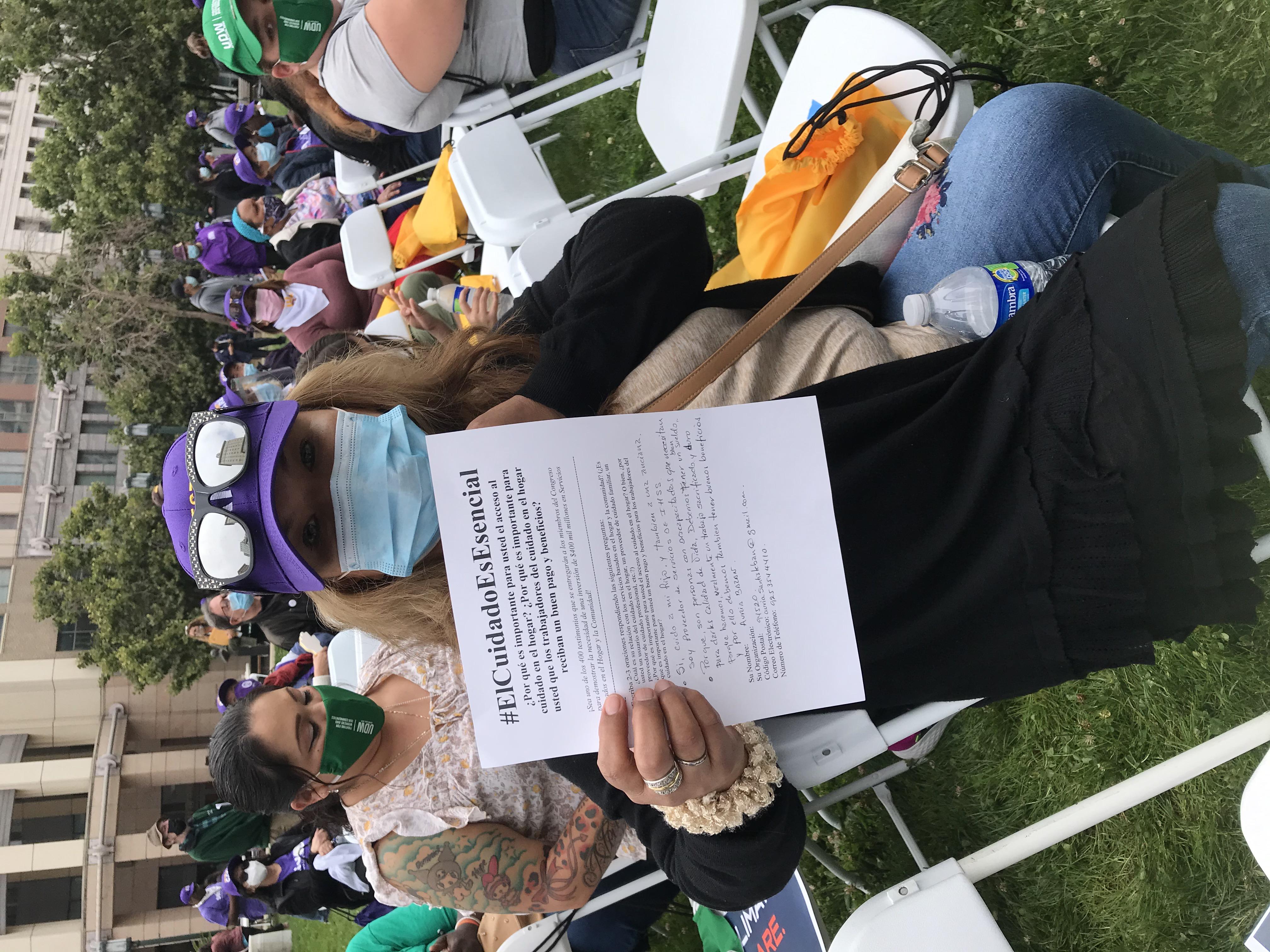 Image Description: SDA union ally holding a print version of their