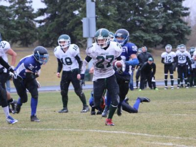 #27 Shawn Francois of the Creighton Kodiaks scoring one of his three touchdowns of the game