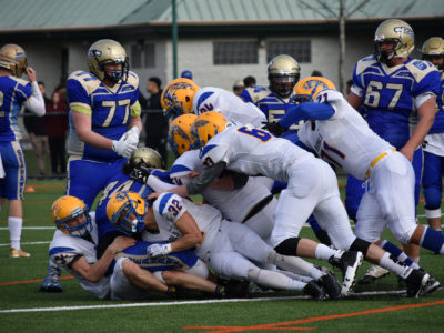 Handsworth Royals pile on Seaquam Seahawks BCSHFB (credit: Katie Burt, CFC)