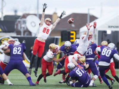 Players from the the Laval Rouge et Or attempt to block a field goal attempt by Western Mustangs kicker Marc Liegghio (80), which missed, during first-half Vainer Cup football action in Hamilton, Ont., on Saturday, November 25, 2017. Peter Power / THE CANADIAN PRESS