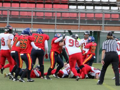 Matwyczuk (#98) in action with Team Canada at the 2013 IFAF Women's Worlds