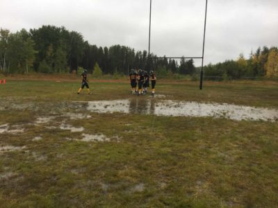 Pinehouse Lakers prepare before a cold and wet game