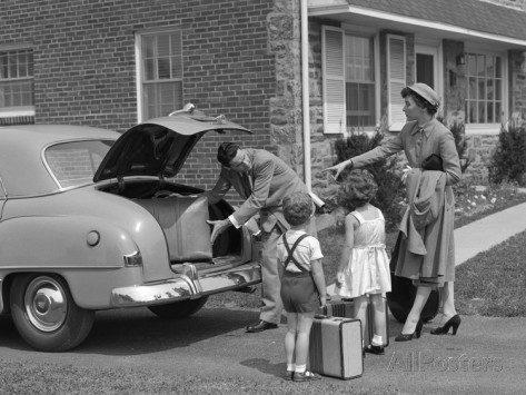 1950s-family-putting-luggage-suitcases-into-trunk-of-car