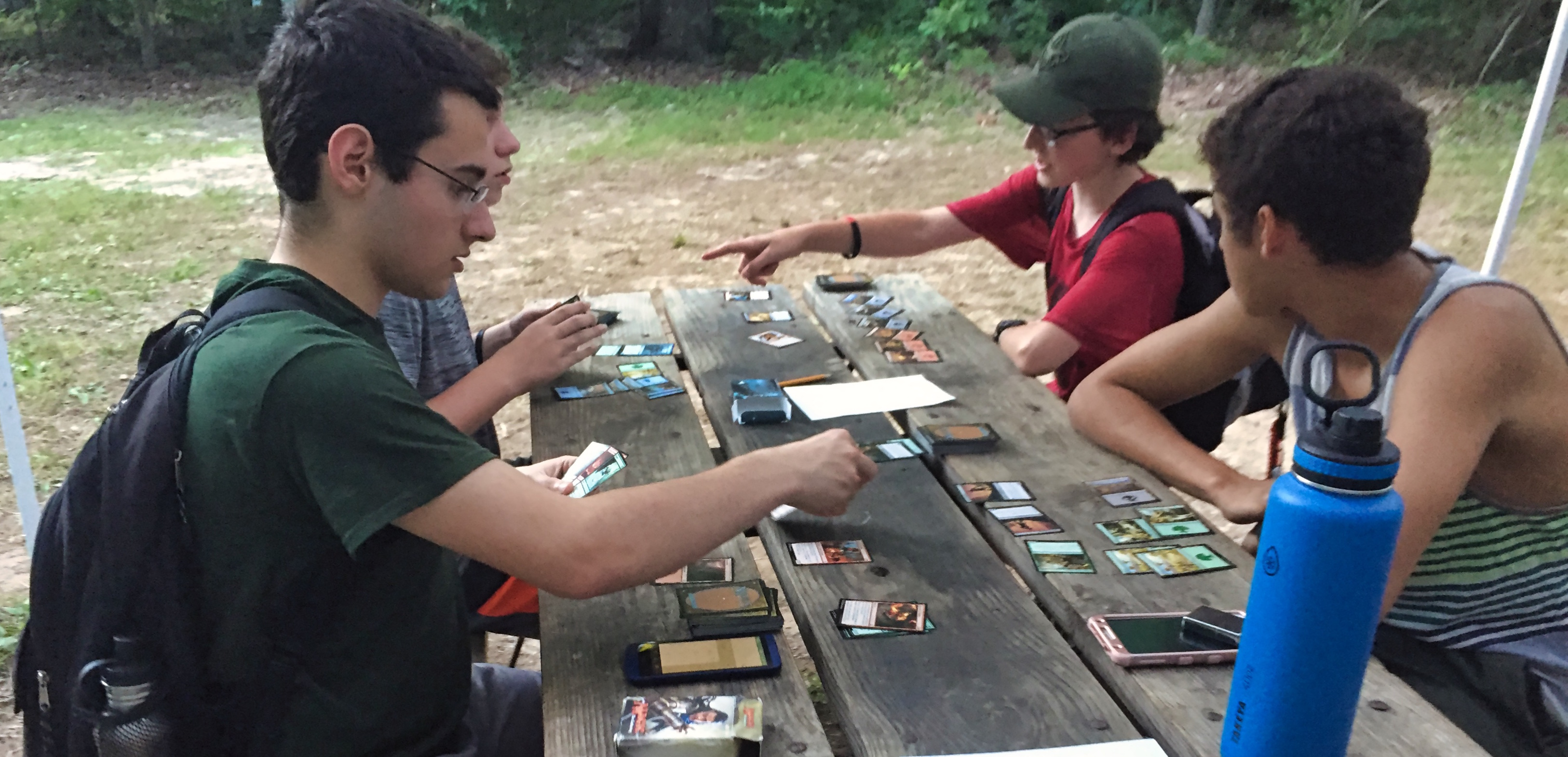 MTG-Camp-Using-Picnic-Tables-Outside
