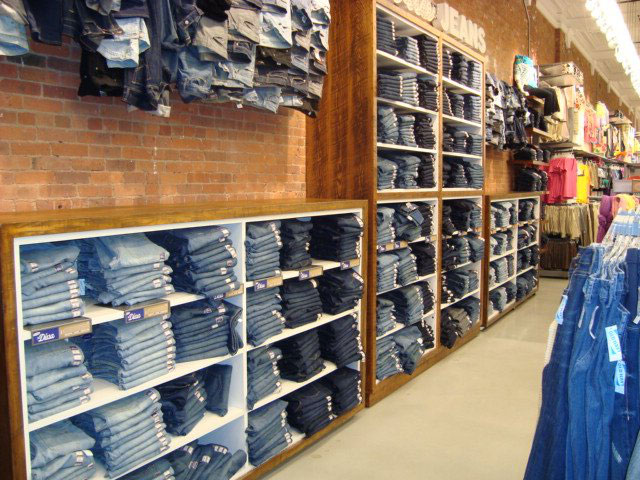 Image of a jeans wall perimeter fixture solution in natural wood