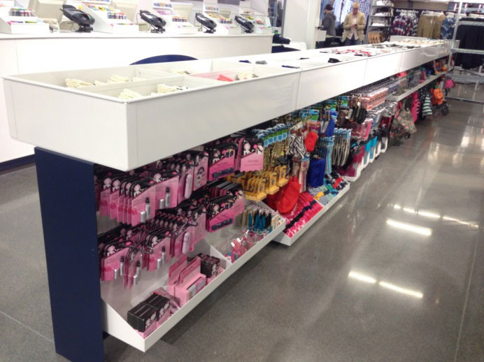 Image of queue line with impulse items in bins and on hooks