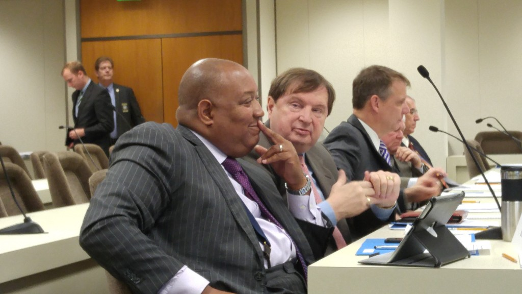 State Sens. Joel Ford, D-Mecklenburg (at left), and Fletcher Hartsell, R-Cabarrus, discuss tax revisions at a Tuesday legislative committee meeting. (CJ Photo by Barry Smith)