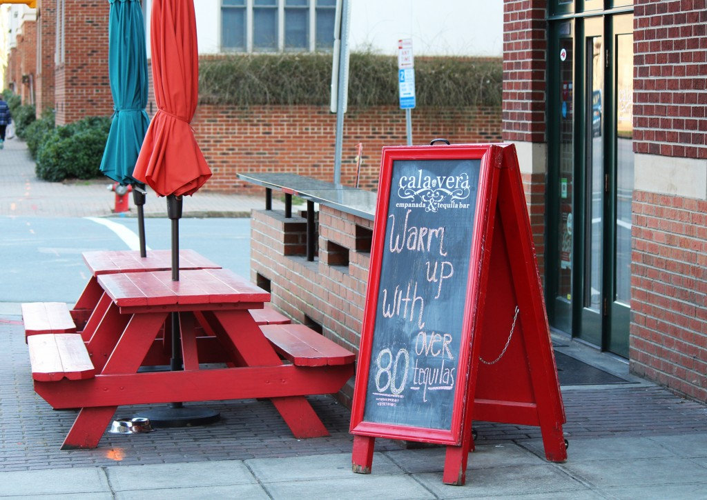 Picnic tables like these at Calavera Empenadas and Tequila Bar in downtown Raleigh were outlawed in 2016 because the benches are attached. (CJ Photo by Kari Travis)