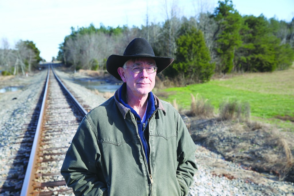 Standing on the Norfolk Southern rail line that borders the northern boundary of the megasite, megasite opponent Alan Ferguson wonders why the North Carolina Railroad Company plans to spend $13 million to by property that it never  will serve. (CJ Photo by Don Carrington)