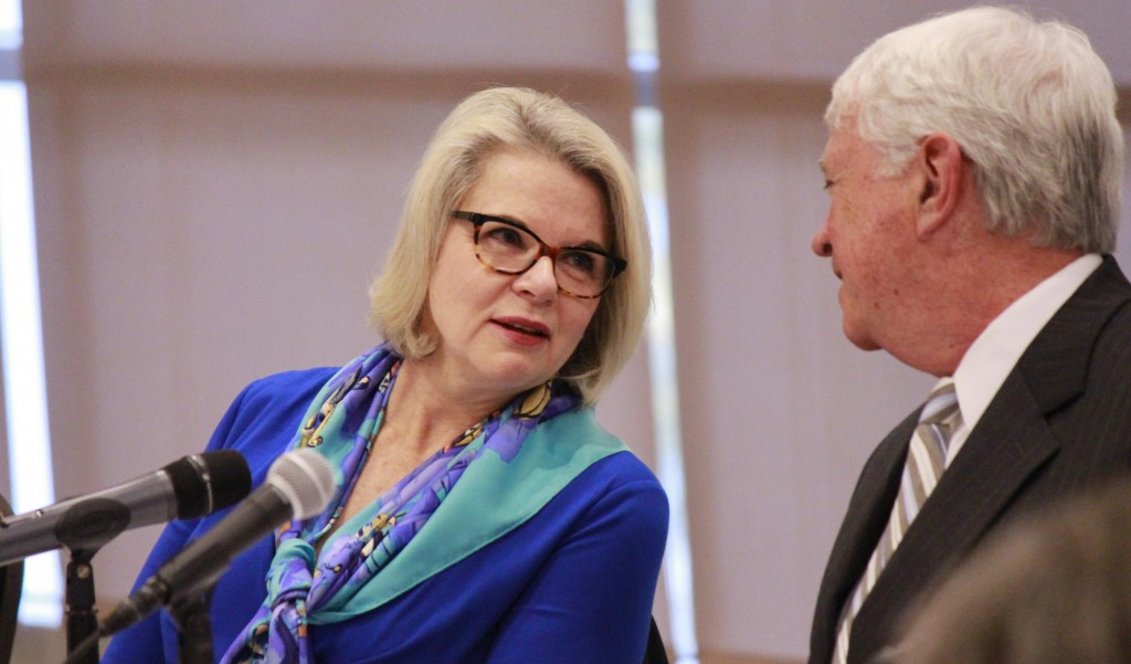 UNC President Margaret Spellings talks with Board of Governors Chairman Lou Bissette Friday during a March 2016 meeting. (CJ Photo by Kari Travis)