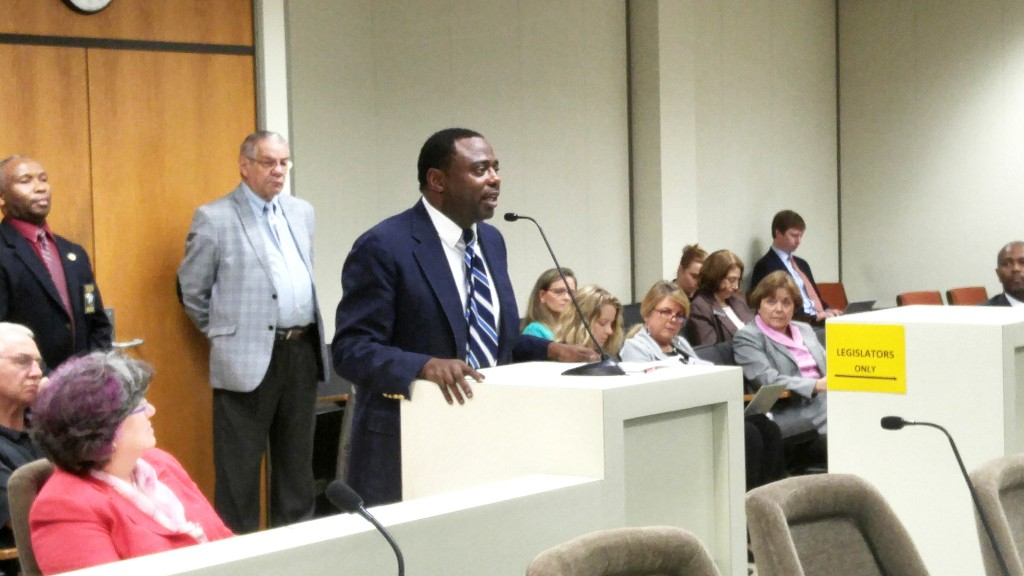 School-choice advocate and former state Rep. Marcus Brandon, D-Guilford, seen here speaking before a legislative hearing in April, says some charter school operators should be concerned about excessive state regulations. (CJ photo by Barry Smith)