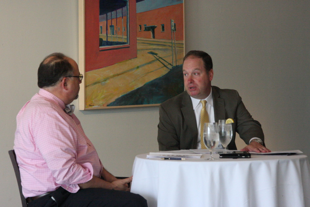 Jim Burton, director of the state House of Representatives Republican caucus, discusses 2016 election prospects at a Monday luncheon hosted by the N.C. FreeEnterprise Foundation. Foundation president Joe Stewart is at left. (CJ photo by Dan Way)