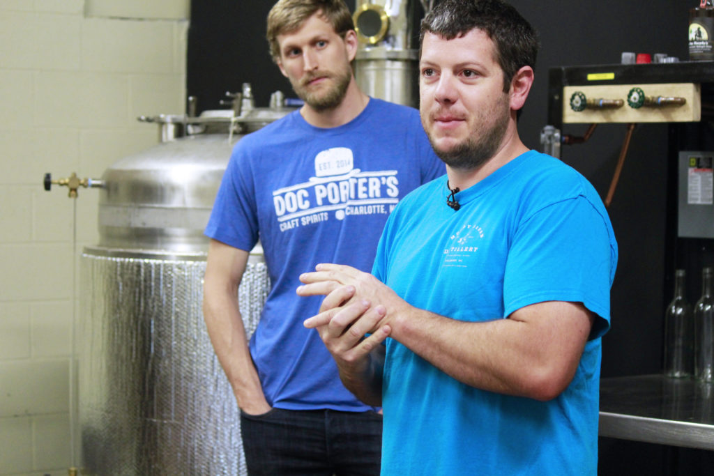 Robbie Delaney leads a tour of Muddy River Distillery in Belmont, telling North Carolina lawmakers about how ABC liquor laws make it difficult to operate in the market. (CJ photo by Kari Travis)