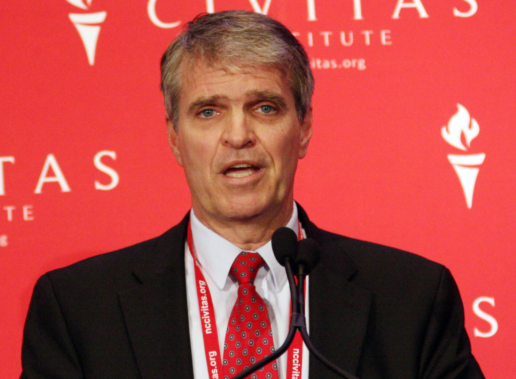 Chuck Stuber, Republican candidate for state auditor, shown speaking in March at the Civitas Institute's Conservative Leadership Conference, said Thursday the FBI normally would not comment publicly on criminal investigations. (CJ photo by Dan Way)