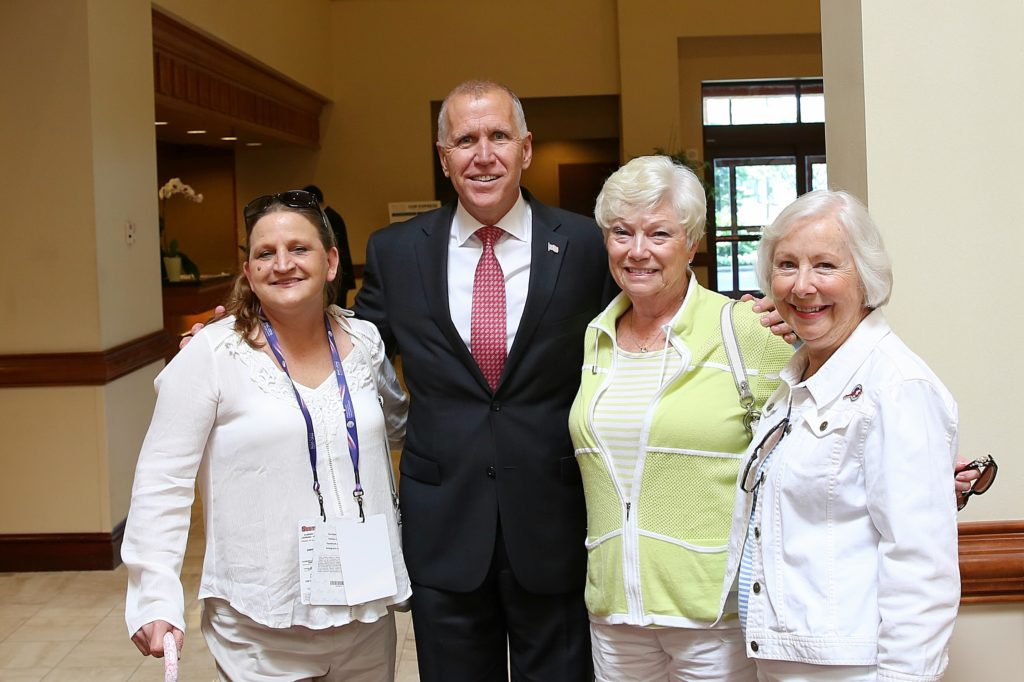 """U.S. Sen. Thom Tillis, shown here with supporters at the Republican National Convention, says presumptive Democratic nominee Hillary Clinton would maintain what he called """"failed"""" Obama administration policies.  (CJ photo by Don Carrington)"""