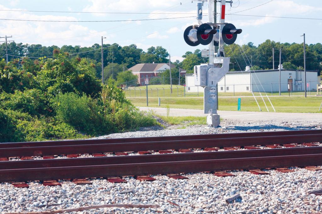 The southwest corner of the CSX transit hub property is near this spot, where railroad crosses College Road in Rocky Mount, near Highway 301 and N.C. Wesleyan College, whose building can be seen in the distance. (CJ photo by Don Carrington)