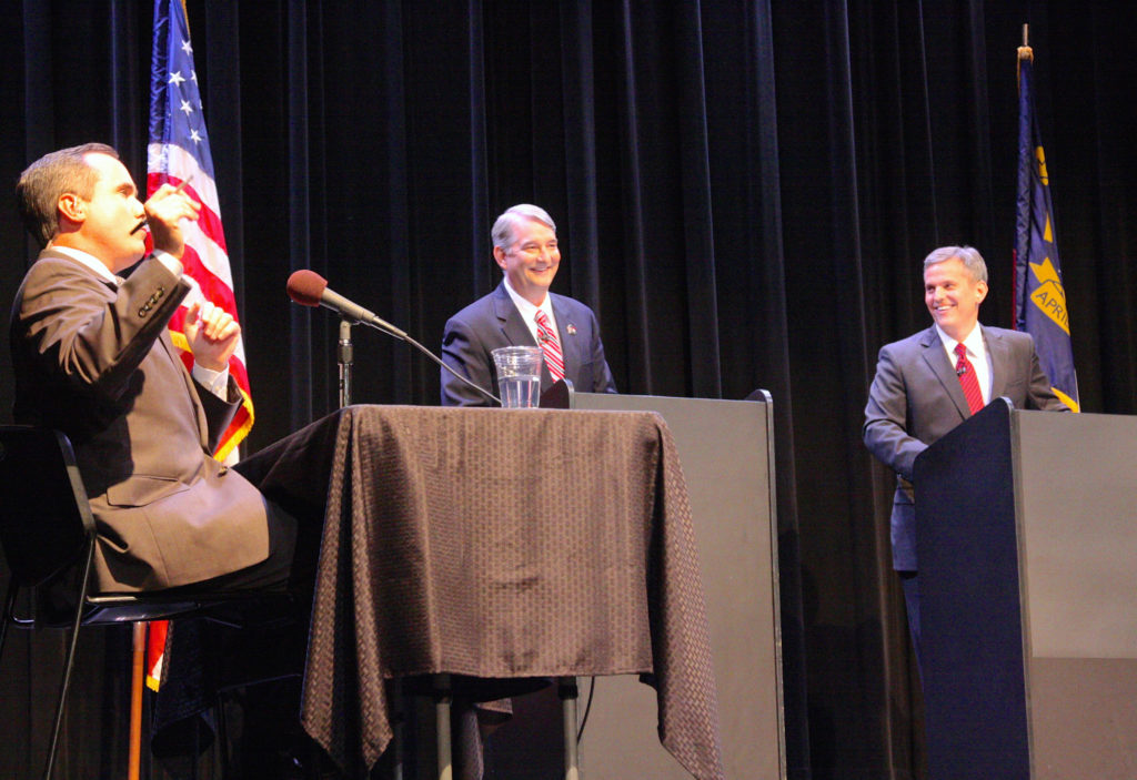 Moderator Kelly McCullen of UNC-TV shares a lighter moment with Republican Buck Newton (left) and Democrat Josh Stein (right) at Tuesday's Hometown Debate between attorney general candidates in Asheboro. (CJ photo by Dan Way)