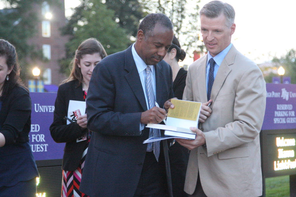 Dr. Ben Carson autographs a book for Durham-based family practice physician Dr. David Fisher. Fisher attended a health care reform town hall featuring Carson Wednesday at High Point University.