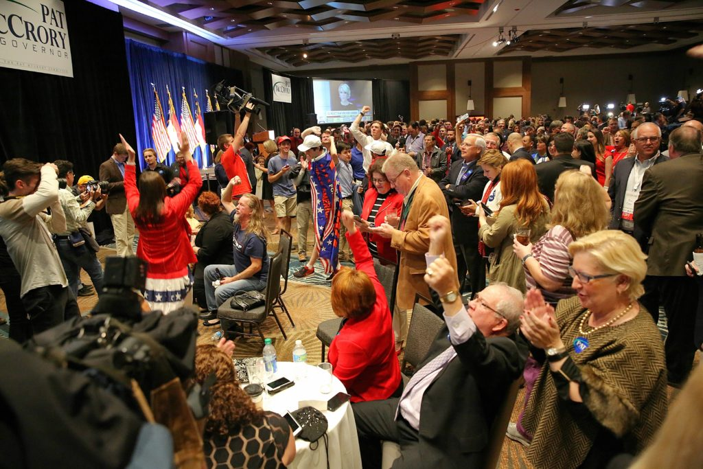 At the Republican victory party in Raleigh, supporters cheer the moment North Carolina was called for Donald Trump in the presidential race. (CJ photo by Don Carrington)