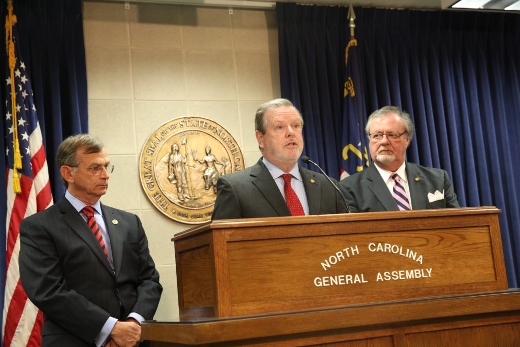 Senate leader Phil Berger, flanked by Sens. Bill Rabon (left) and Tommy Tucker (right), explain at a Feb. 23 press conference steps the Senate may take to compel Larry Hall's attendance at his confirmation hearing. (CJ Photo by Don Carrington)