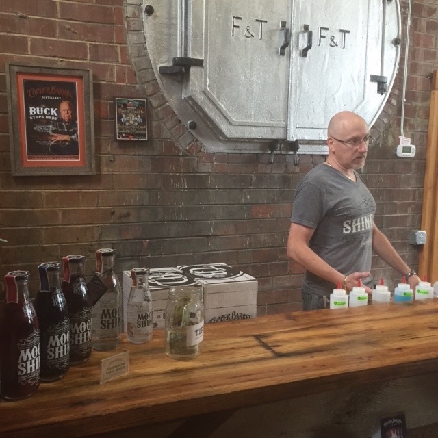 George Smith, behind the tasting bar at his Copper Barrel Distillery in North Wilkesboro. (Photo by Lisa Snedeker)