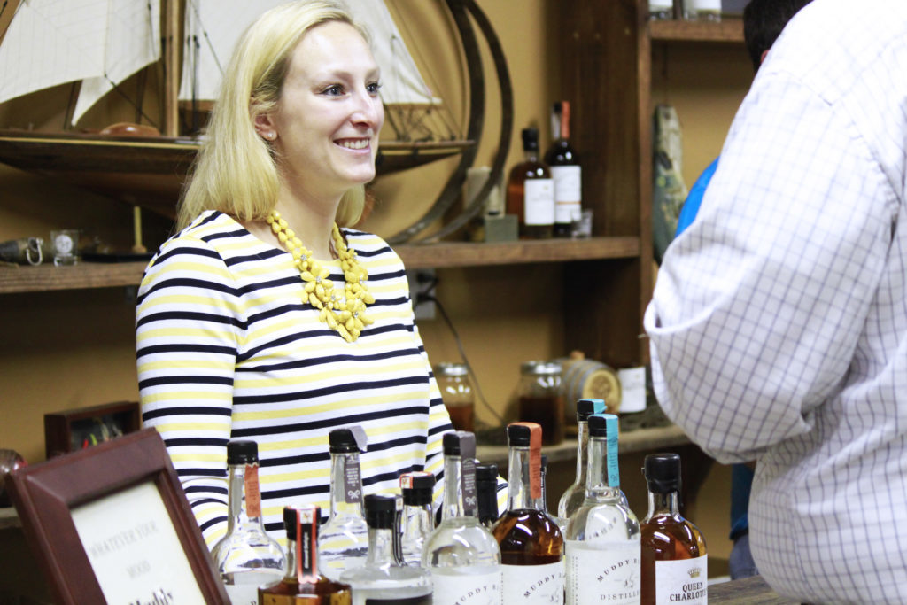 Muddy River Distillery co-owner Caroline Delaney serves customers during a May 2016 tour. (CJ Photo by Kari Travis)